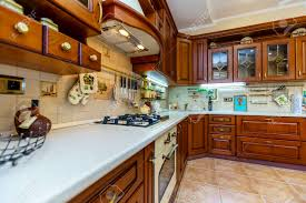 modern kitchen with cherry wood cabinets warm and inviting kitchen with large kitchen island cherrywood