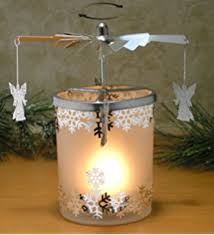spinning candle silver charms spin around this