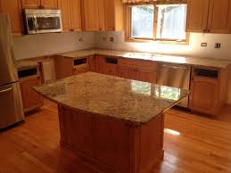 granite countertop contrasting kitchen cabinets faux stone