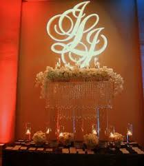 wedding backdrop monogram bling sweetheart table with curtain backdrop and bling