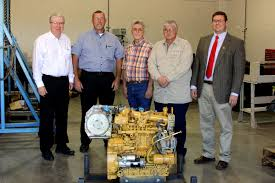 mustang cat area business donates diesel engines to ac program