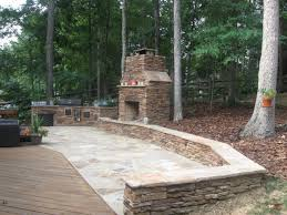 Patio Stone Flooring Ideas by Exciting Outdoor Kitchen With Fireplace Featuring Stone Outdoor