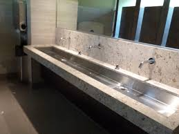 white granite and steel undermount double trough sink above black