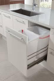 kitchen design idea hide pull out trash bins in your cabinetry