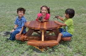 small kids round wooden picnic table with benches without umbrella