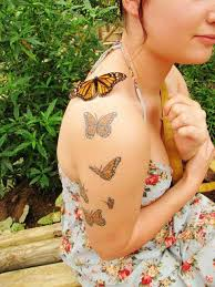 beautiful tattoos of butterflies on arm photo design idea for