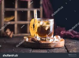 whiskey photography cocktail iced tea whiskey orange ice stock photo 536916958