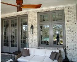 image result for grey brick house blue trim house exterior
