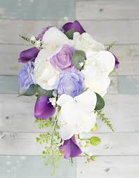 lavender roses touch white purple and lavender roses orchids and callas