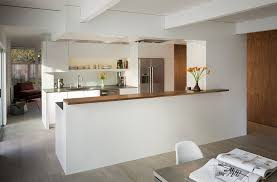 kitchen island wall connect the kitchen with the dining space with a half wall