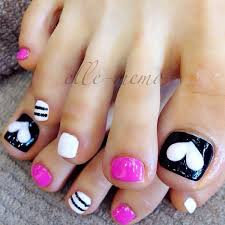black and white toenail design accented with heart and strips