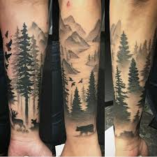 black and grey forest on forearm tattoos
