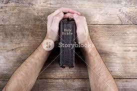 Wooden Desk Background Hands Holding Bible On A Wooden Desk Background Royalty Free