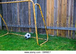 soccer goal post and net detail on green turf stock photo royalty