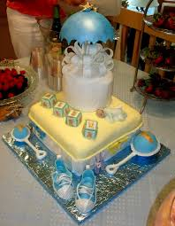 baby shower cake for boy with umbrella baby blocks baby rattles