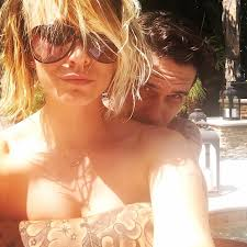 kaley cuico naked kaley cuoco poses topless while husband ryan sweeting gives her a