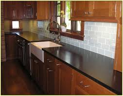 subway tile kitchen backsplash with dark cabinets home design ideas