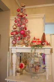 pretty i would use fishing line and different decorations and