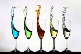 beautiful wine glasses liquid leaping from wine glasses