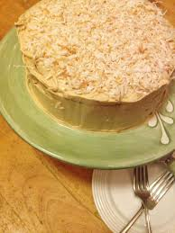 vanilla cake with carrot cake filling u0026 peanut butter frosting