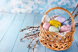 filled easter baskets easter basket filled with colorful eggs on a blue background stock