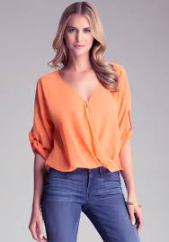 bebe blouses lyst bebe twist front zipper top in orange