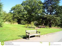 Royal Botanic Gardens Kew by Wooden Bench Or Seat In The Royal Botanic Gardens Kew London