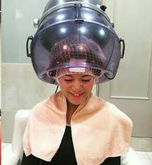 sissy boys under hair dryers he so happy under the dryer with his hair all tightly wound in