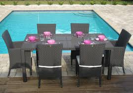 modern rattan dining set for outdoor pool deck with concrete