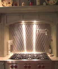 Pictures Of Stainless Steel Backsplashes by Behind The Range A Stainless Steel Backsplash Stamped In A