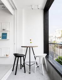 minimal tel aviv apartment features bespoke gridded shelving