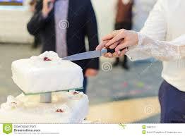 cutting cake at wedding symbolism cutting the wedding cake
