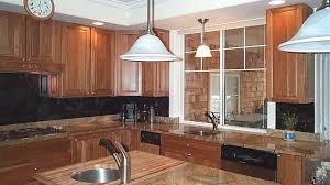 cherry kitchen cabinets with granite countertops black granite