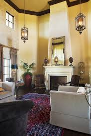 Mirror Over Buffet by Mirror Over Fireplace Living Room Traditional With Old World Metal