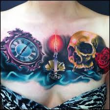 cool clock with burning candle and skull tattoo on collarbone