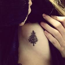 small pine tattoo on side