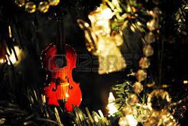 miniature tree with tiny ornaments amid falling snow