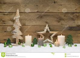 natural christmas window decoration of wood with snow stock photo