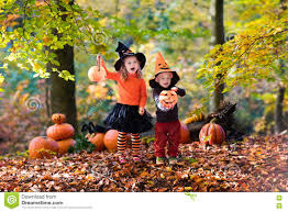 kids with pumpkins on halloween stock photo image 77153276