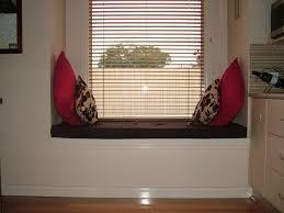 miniamlist white bay window couch with brown tufted pad also pink miniamlist white bay window couch with brown tufted pad also pink pillows near window shutter