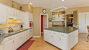 how do you reface kitchen cabinets yourself should i paint or refinish my kitchen cabinets angi