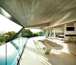 a sculptural cliffside home with a breathtaking tropical view