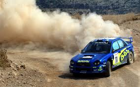 subaru wrc wallpaper blue subaru drifting leaving a massive dust cloud in its wake