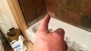 how to repair tile around a bathtub youtube