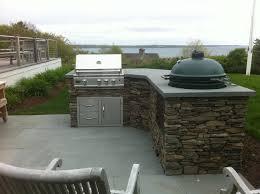 big green egg built into outdoor kitchen outofhome