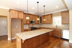 hickory cabinets with granite countertops hickory cabinets line the kitchen walls with a brick tile