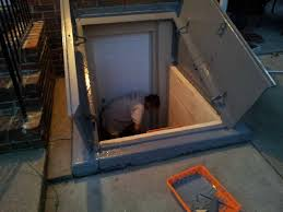 basement stained concrete in basement adding an egress window to