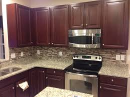 travertine backsplash with santa cecilia countertop kitchen