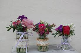 jar table decorations country pinks jam jar table decorations guild floral design