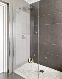 dark grey concrete shower room with copper shower bathroom metal